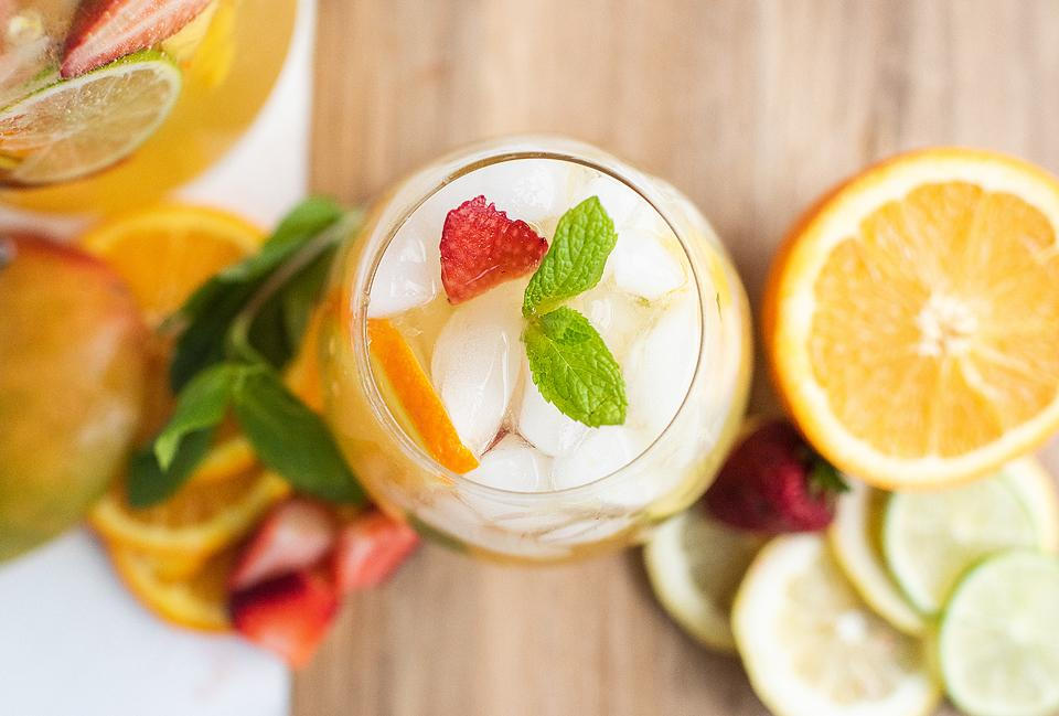 Food blogger, Bella Bucchiotti of xoxoBella, shares a mango citrus berry white sangria recipe. You will love this summer fruit cocktail recipe.