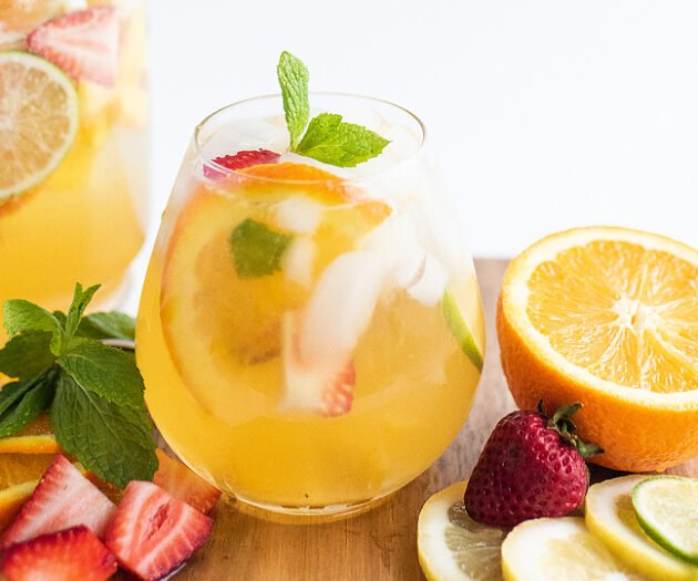 Food blogger, Bella Bucchiotti of xoxoBella, shares a mango citrus berry white sangria recipe. You will love this refreshing summer drink!