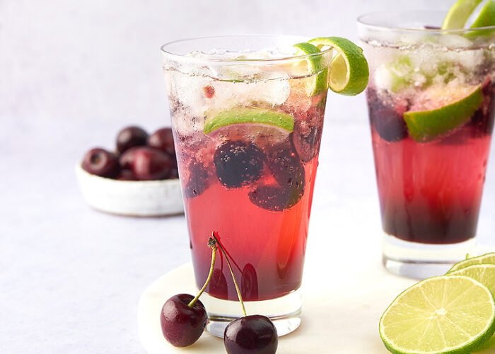 Food blogger, Bella Bucchiotti of xoxoBella, shares a recipe for a Cherry Lime Caipirinha which is Brazilian cocktail with cherries and cachaca or dark rum.