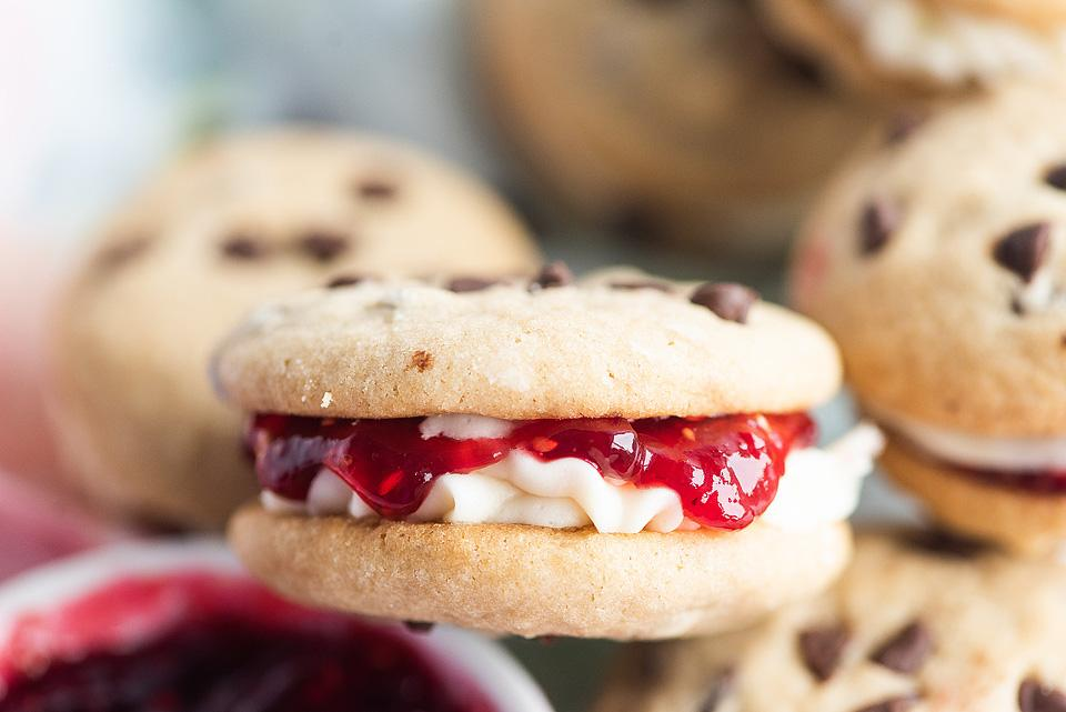 Food blogger, Bella Bucchiotti of xoxoBella, shares a recipe for raspberry  chocolate chip buttercream jam sandwich cookies. You will love the sandwich cookie filling.