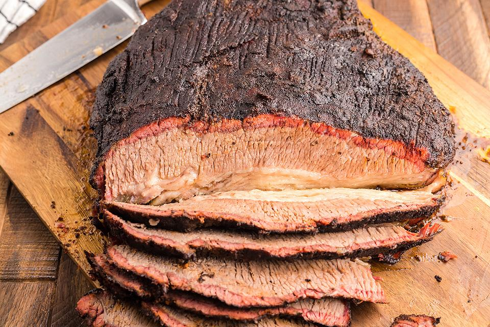 Food blogger, Bella Bucchiotti of xoxoBella, shares a smoked dry rub brisket made in a Traeger grill or a pellet grill. You will love this easy Texas smoked brisket recipe!