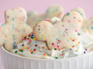 Food blogger, Bella Bucchiotti of xoxoBella, shares a recipe for Disney cookies with cream cheese sprinkle dip. You will love these Mickey Mouse cookies with Funfetti Dunkaroo dip!