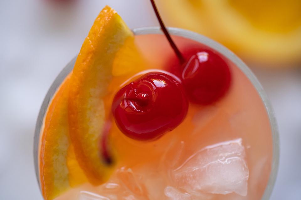 Food blogger, Bella Bucchiotti of xoxoBella, shares how to make a rum runner cocktail. You will love this Caribbean inspired pineapple rum drink recipe.