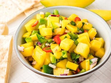 Food blogger, Bella Bucchiotti of xoxoBella, shares a chunky mango salsa made with fresh mangoes. You will love this summer Mexican fruit salsa!