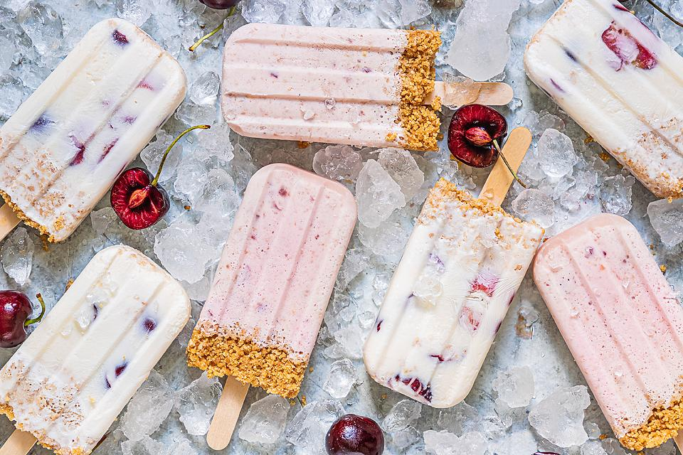 Food blogger, Bella Bucchiotti of xoxoBella, shares a recipe for cherry cheesecake popsicles. You will love these cherry dessert popsicle.