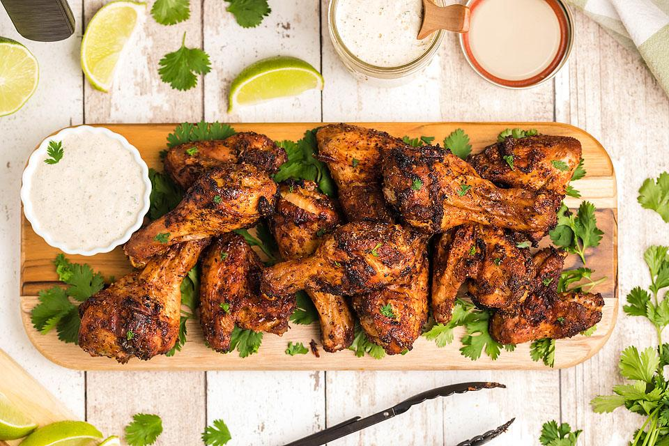 Food blogger, Bella Bucchiotti of xoxoBella, shares a air fryer chipotle chicken wings with buttermilk firecracker ranch recipe. You will love this tasty air fryer chicken recipe!