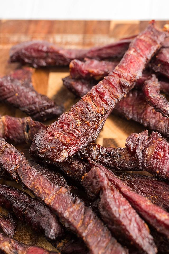 Food blogger, Bella Bucchiotti of xoxoBella, shares a smoked beef jerky recipe for a pellet grill or a smoker. All the directions for how to make smoked beef jerky.