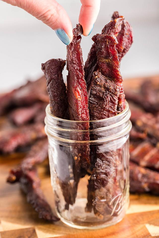 Food blogger, Bella Bucchiotti of xoxoBella, shares a smoked beef jerky recipe for a pellet grill or a smoker. You will love this gluten free and paleo beef jerky.