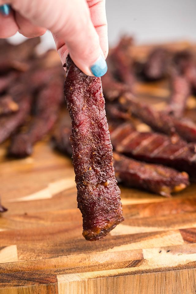 Food blogger, Bella Bucchiotti of xoxoBella, shares a smoked beef jerky recipe for a pellet grill or a smoker like a Traeger grill. You will love this healthy homemade beef jerky!