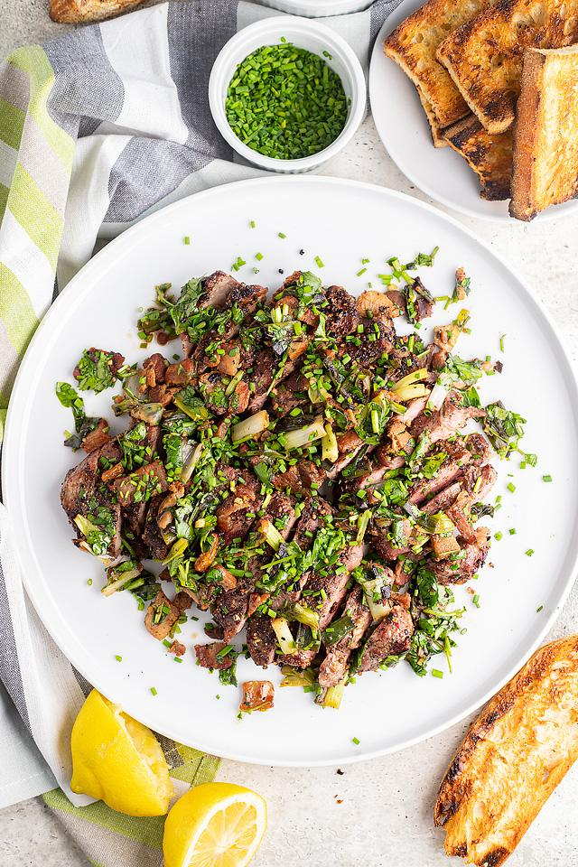 Food blogger, Bella Bucchiotti of xoxoBella, shares a recipe for grilled New York steak with bacon and scallions. You will love this BBQ steak recipe!