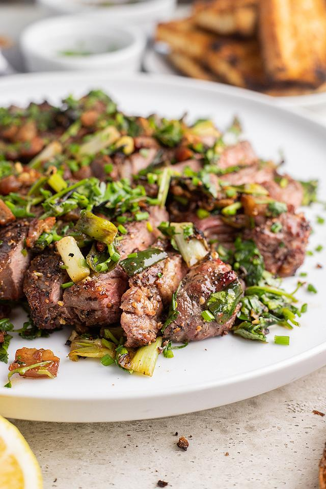 Food blogger, Bella Bucchiotti of xoxoBella, shares a recipe for grilled New York steak with bacon and scallions. You will love this grilled steak topping!