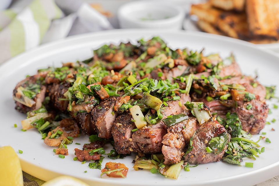 Food blogger, Bella Bucchiotti of xoxoBella, shares a recipe for grilled New York steak with bacon and scallions. All the details for how to cook New York steak on a grill.