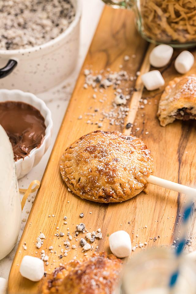 Food blogger, Bella Bucchiotti of xoxoBella, shares a recipe for air fryer s'more pie pops with Nutella. Perfect if you are looking for summer BBQ dessert ideas.