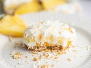 Food blogger, Bella Bucchiotti of xoxoBella, shares a coconut pineapple lush no bake cake recipe. You will love this creamy summer dessert.