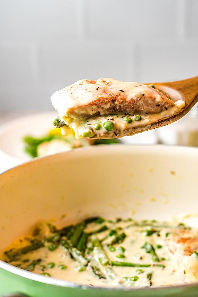 Food blogger, Bella Bucchiotti at xoxoBella, shares salmon and fresh vegetables with a creamy white wine sauce. Learn how to cook Salmon for dinner.