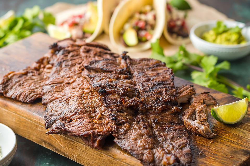 Food blogger, Bella Bucchiotti of xoxoBella, shares a marinated grilled flank steak tacos. You will love this tasty casne asada marinade.