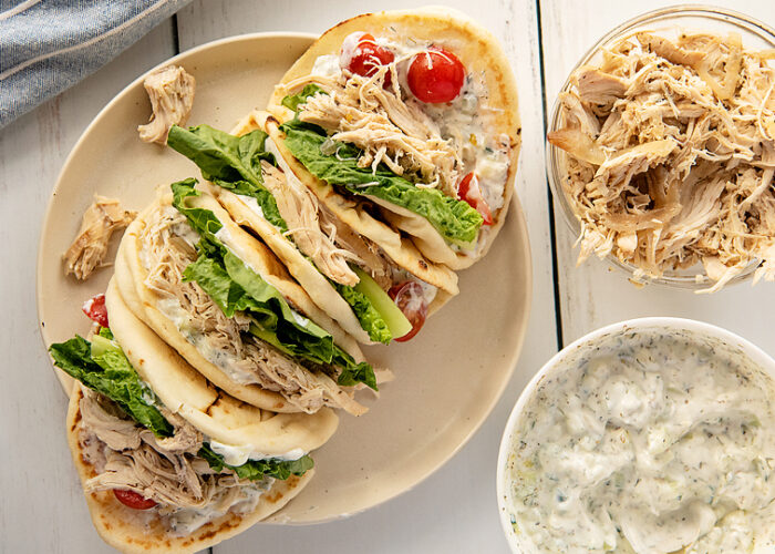Food blogger, Bella Bucchiotti of xoxoBella, shares a recipe for slow cooker Greek shredded chicken gyros with homemade tzatziki sauce. You will love this slow cooker chicken recipe!