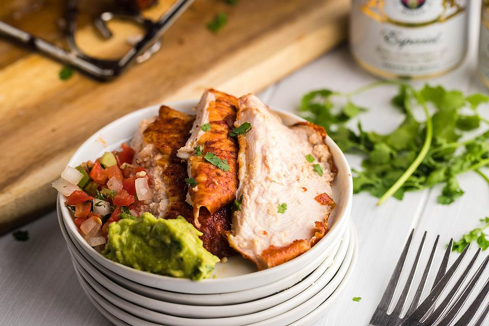 Food blogger, Bella Bucchiotti of xoxoBella, shares a Traeger pellet grilled smoked beer can chicken recipe. You will love the Mexican BBQ sauce, too!