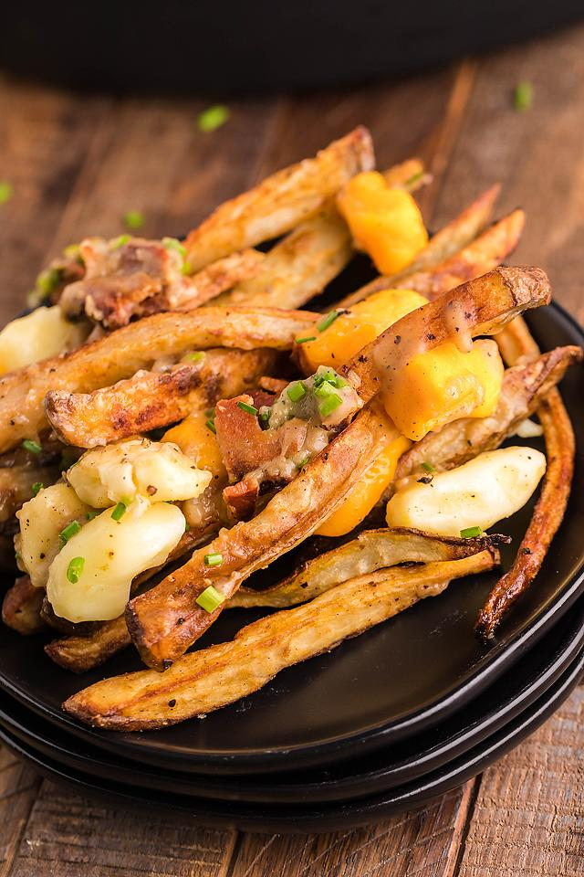 Food blogger, Bella Bucchiotti of xoxoBella, shares a Canadian poutine recipe. A perfect potato side dish for a Canada Day meal.