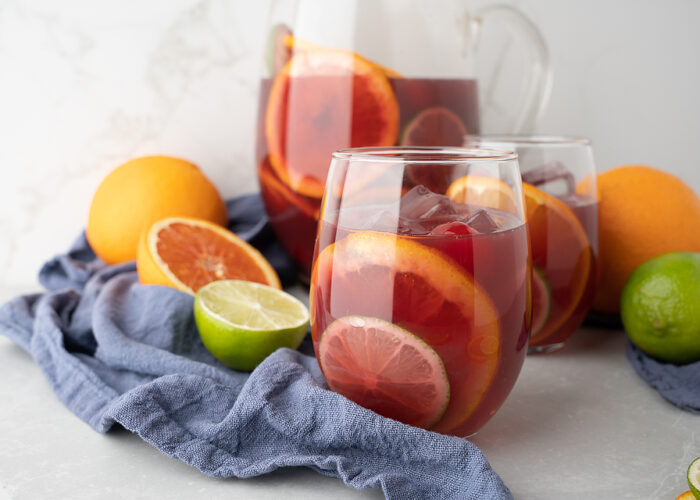 Food blogger, Bella Bucchiotti of xoxoBella, shares a fruity rum red wine sangria. You will love this Pinot Noir fruit sangria for summer!
