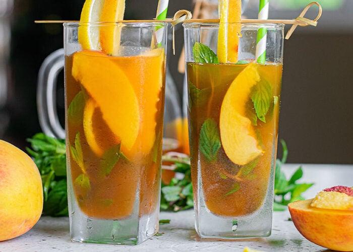 Food blogger, Bella Bucchiotti of xoxoBella, shares a recipe for spiked peach iced tea lemonade. You will love this alcoholic peach tea!