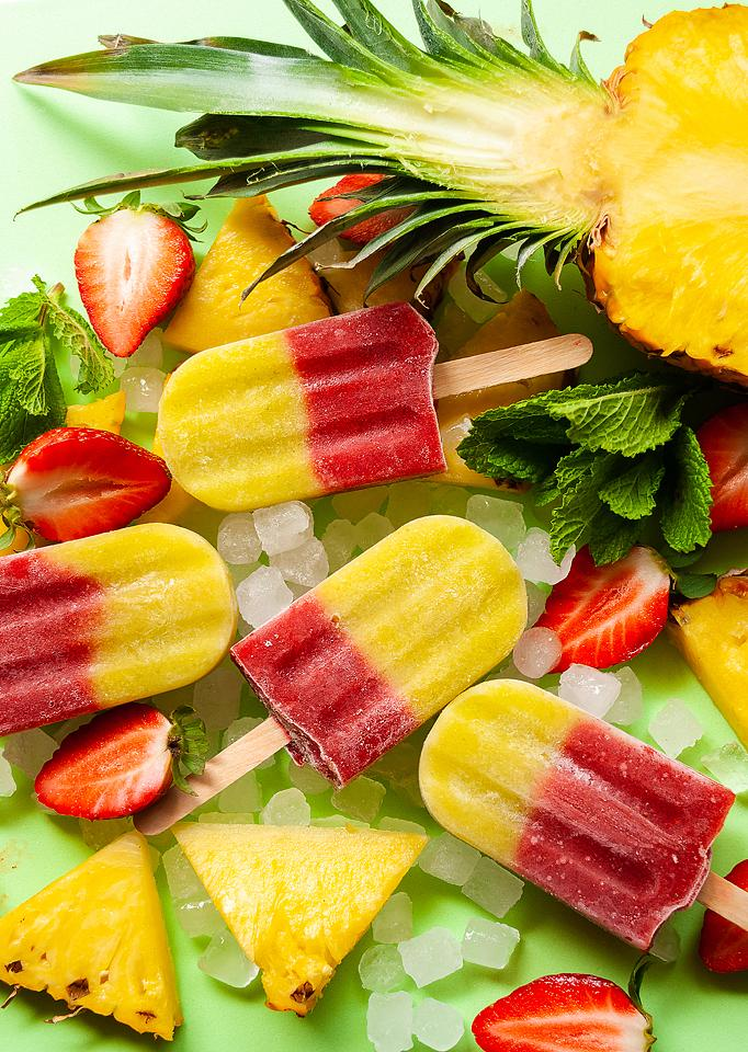 Food blogger, Bella Bucchiotti of xoxoBella, shares a recipe for layered strawberry pineapple mint popsicles. You will love this easy layered popsicle recipe.