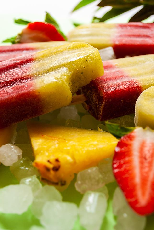 Food blogger, Bella Bucchiotti of xoxoBella, shares a recipe for layered strawberry pineapple mint popsicles. You will love these refreshing ice pops!