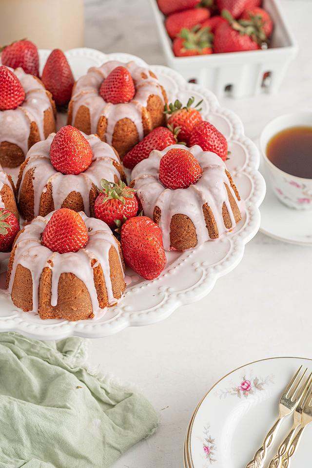 Food blogger, Bella Bucchiotti of xoxoBella, shares a recipe for mini strawberry bundt cakes. You will love this easy strawberry recipe. It is a great dessert for Mother's Day, Easter or a shower.