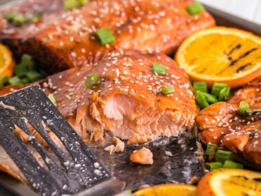 Food blogger, Bella Bucchiotti of xoxoBella, shares a recipe for orange BBQ salmon with foil packet garlic soy vegetables. You will love this 30 minute salmon meal.