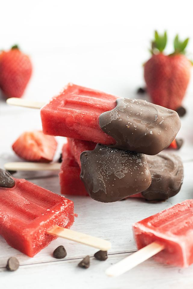 Food blogger, Bella Bucchiotti of xoxoBella, shares a recipe for chocolate dipped strawberry popsicles.  You will love this dipped fruit popsicle recipe.