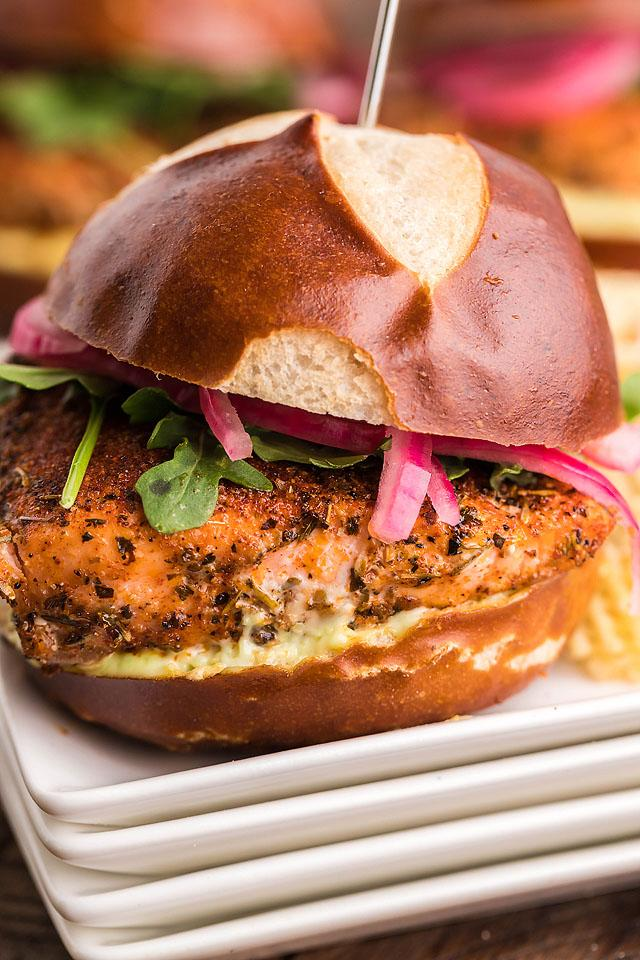 Food blogger, Bella Bucchiotti of xoxoBella, shares a recipe for smoked blackend salmon sliders with wasabi mayo and pickled red onions. They are tasty summer BBQ salmon burgers.