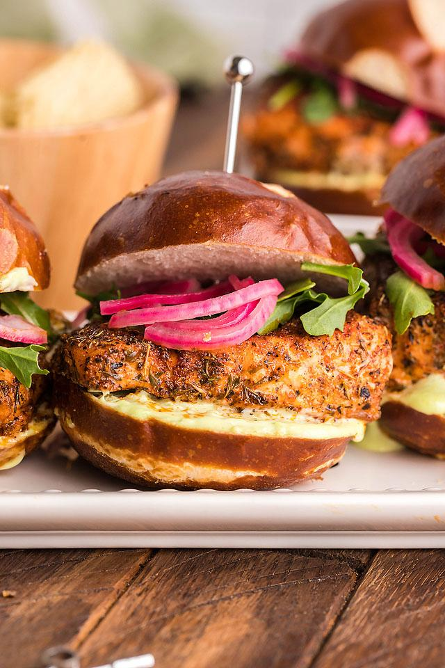 Food blogger, Bella Bucchiotti of xoxoBella, shares a recipe for smoked blackend salmon sliders with wasabi mayo and pickled red onions. They are made in a pellet grill or a Traeger.