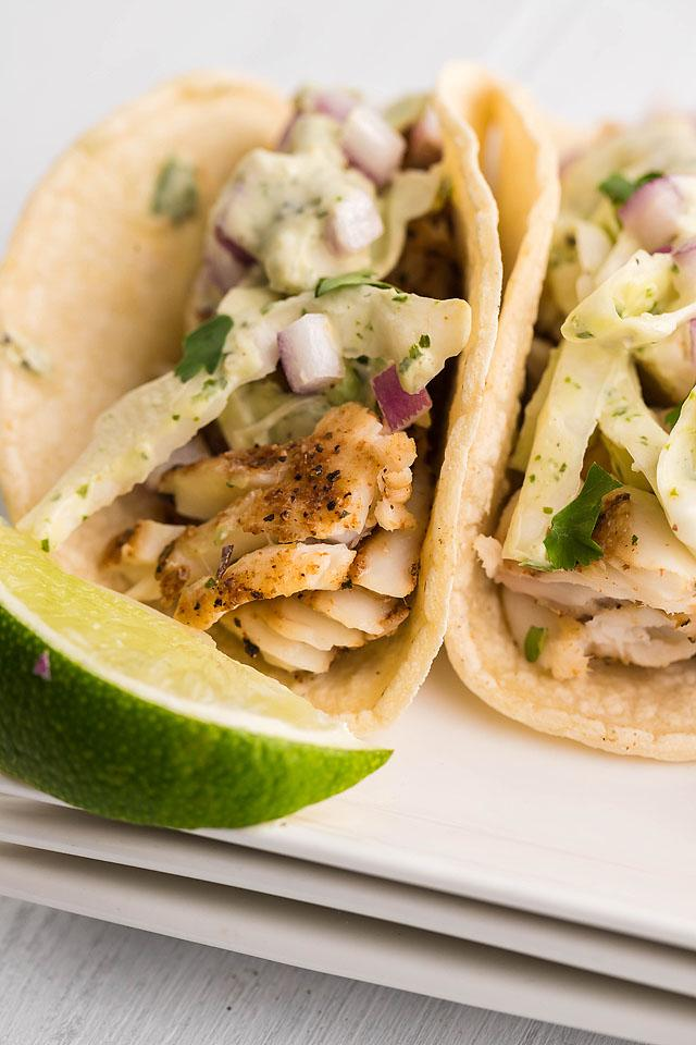 Food blogger, Bella Bucchiotti of xoxoBella, shares a recipe for smoker grilled fish tacos with garlic cilantro lime slaw. You will love this slaw for fish tacos!