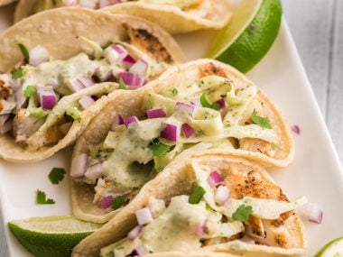 Food blogger, Bella Bucchiotti of xoxoBella, shares a recipe for smoker grilled fish tacos with garlic cilantro lime slaw. You will love these tacos with smoked tilapia!