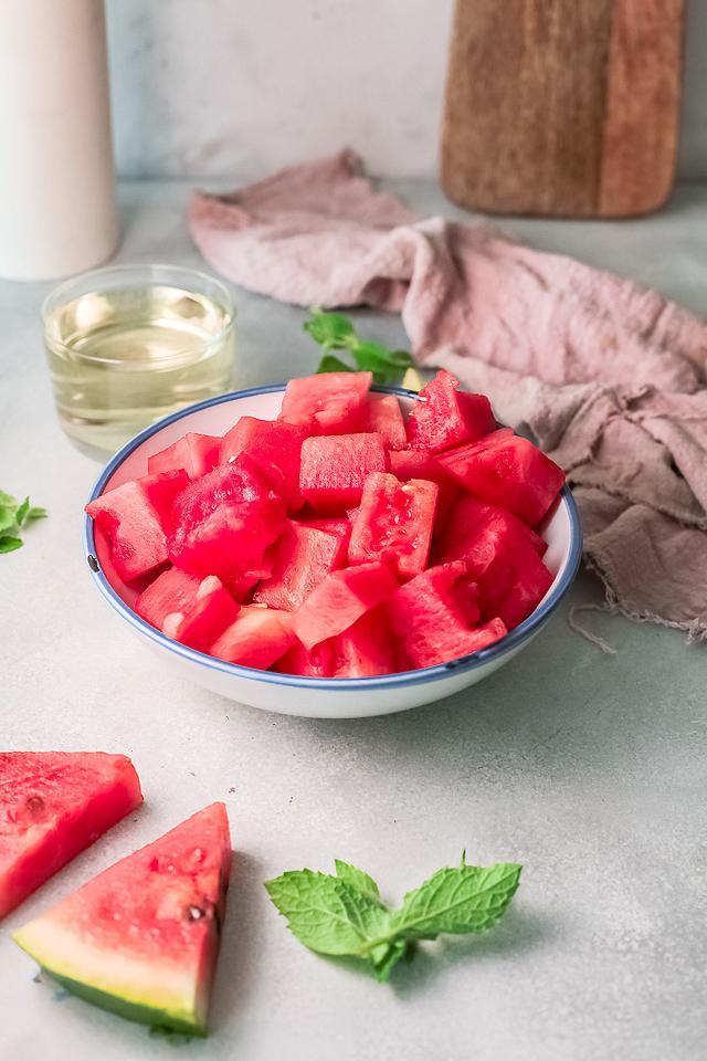 Food blogger, Bella Bucchiotti of xoxoBella, shares a watermelon white wine slushie recipe. You will love this frozen watermelon cocktail!