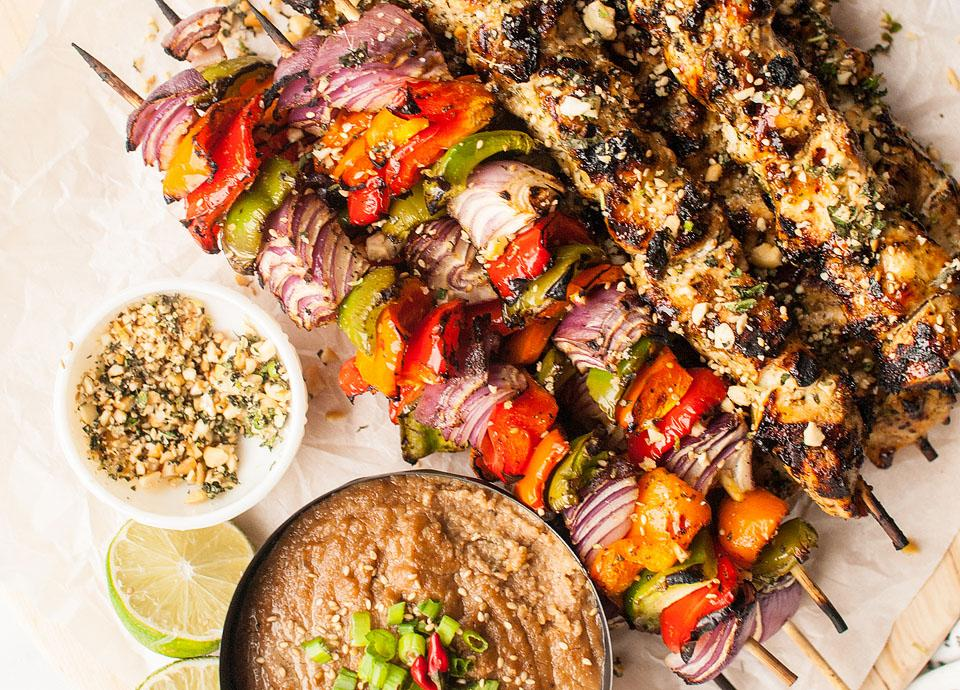 Food blogger, Bella Bucchiotti of xoxoBella, shares a recipe for Thai spicy basil chicken skewers with cashew dipping sauce and gremolata topping.