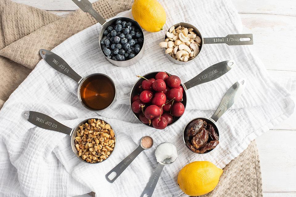 Food blogger, Bella Bucchiotti of xoxoBella, shares some berry cherry layered creamy vegan bars. You will love this vegan layered dessert made with raw cashews!