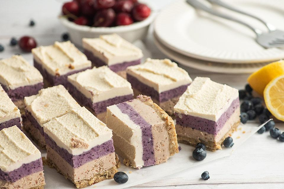 Food blogger, Bella Bucchiotti of xoxoBella, shares some berry cherry layered creamy vegan bars. You will love this no bake vegan cheesecake!