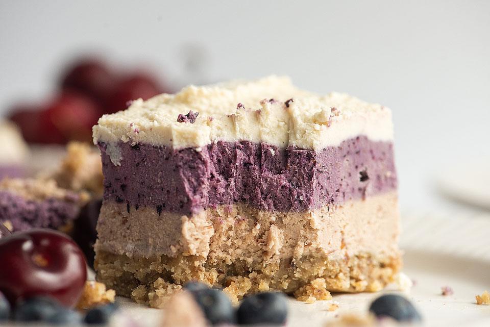 Food blogger, Bella Bucchiotti of xoxoBella, shares some berry cherry layered creamy vegan bars. You will love this no bake raw vegan recipe!