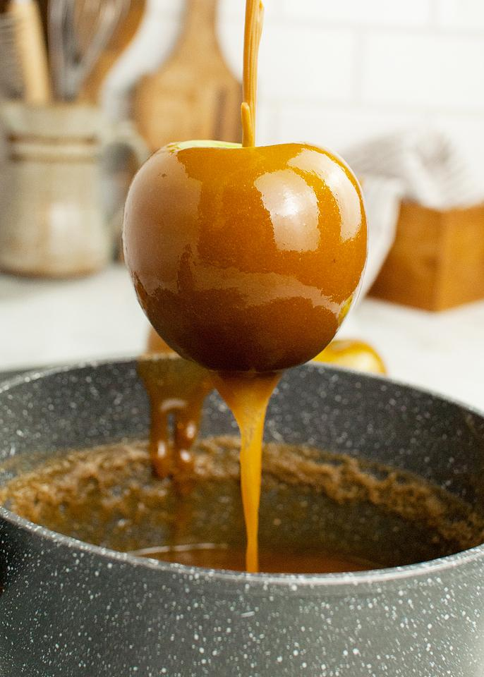 Food blogger, Bella Bucchiotti of xoxoBella, shares some easy DIY caramel apples. Learn how to make caramel apples on a stick.