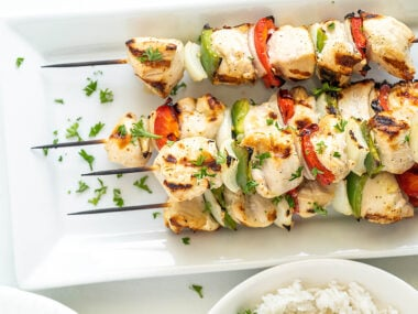 Food blogger, Bella Bucchiotti of xoxoBella, shares a recipe for grilled pepper and chicken kebabs, These tasty chicken skewers make a great summer BBQ dinner.