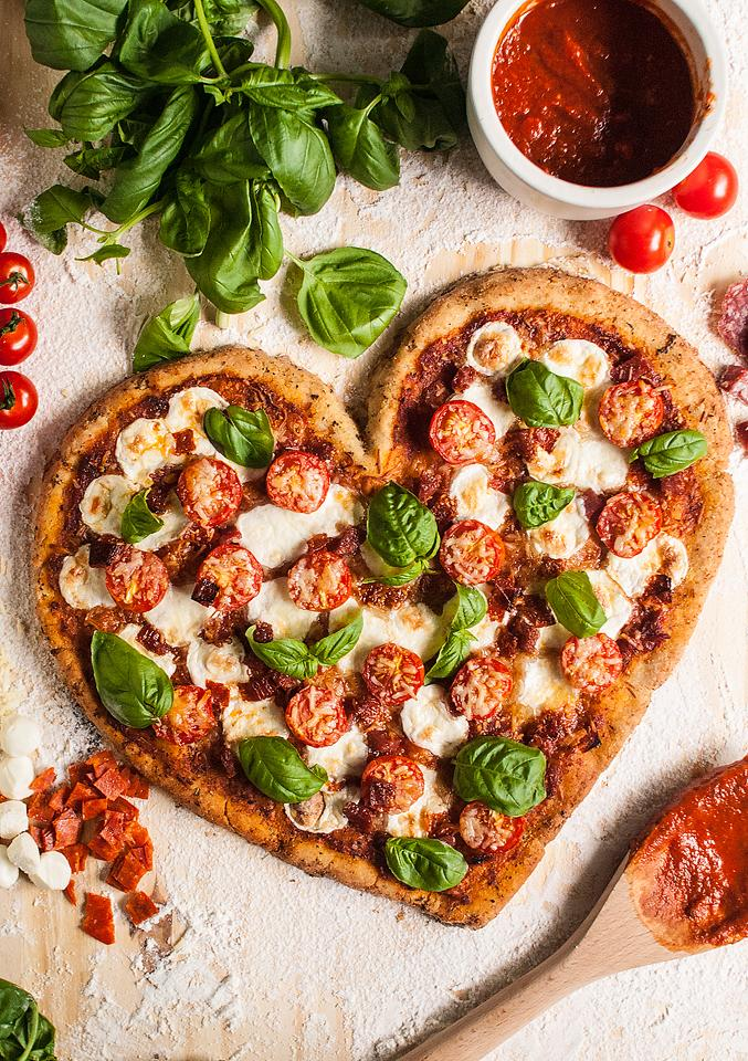 Food blogger, Bella Bucchiotti of xoxoBella, shares a homemade gluten free heart shaped pizza. Learn how to make a heart shaped pizza with gluten free pizza toppings.