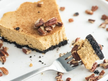 Food blogger, Bella Bucchiotti of xoxoBella, shares a recipe for pumpkin cheesecake with chocolate graham crust. You will love this black bottom pumpkin cheesecake for Thanksgiving or Christmas.