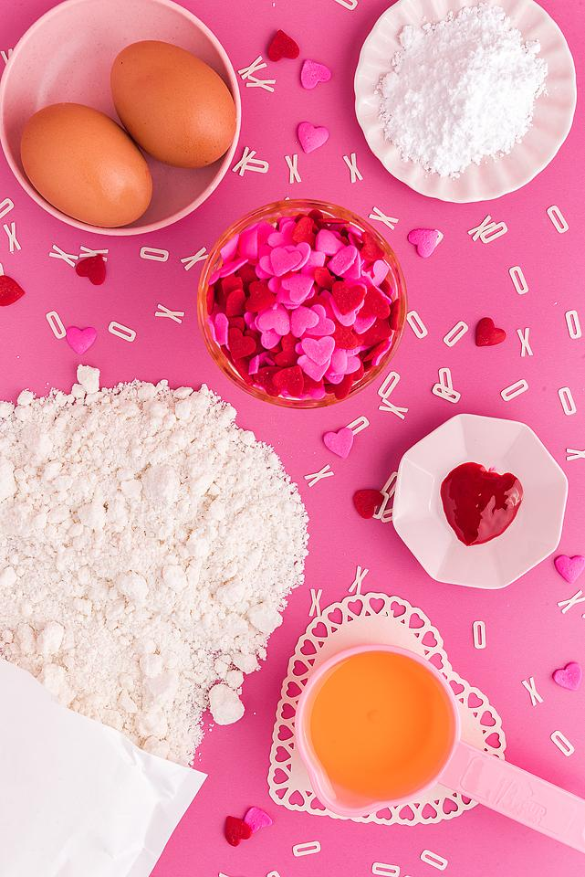 Food blogger, Bella Bucchiotti of xoxoBella, shares a recipe for easy Valentine's cookies with these Valentine crinkle cookies. You will love these pink cookies with heart sprinkles.