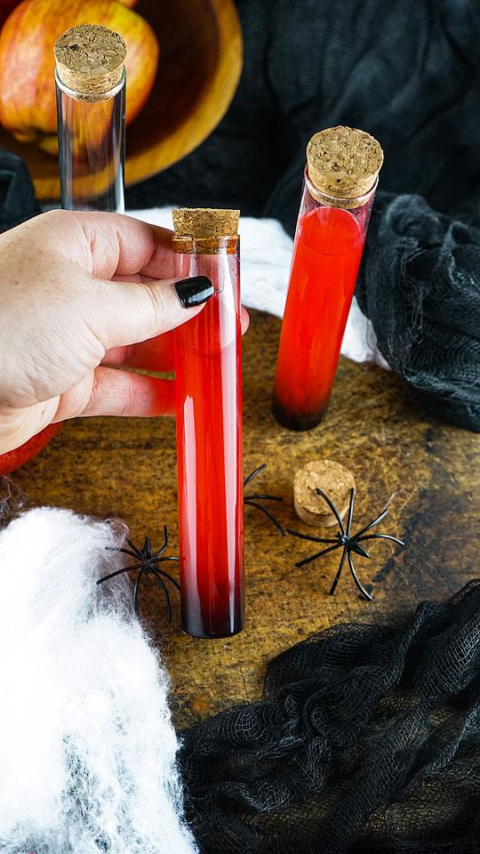 Food blogger, Bella Bucchiotti of xoxoBella shares a recipe for a Halloween vial shooter. You will love these alcoholic shots for Halloween.