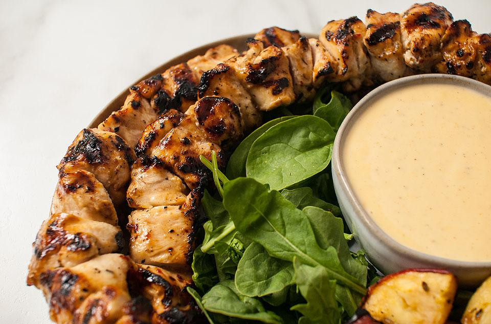 Food blogger, Bella Bucchiotti of xoxoBella, shares a recipe for apple cider grilled chicken skewers with Gouda cheese sauce. You will love this cider chicken dinner!