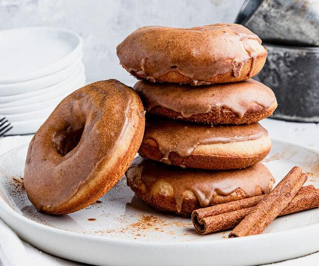 Food blogger, Bella Bucchiotti of xoxoBella, shares a recipe for baked gluten free cinnamon spice glazed donuts. You will love this oven baked donut for Autumn.