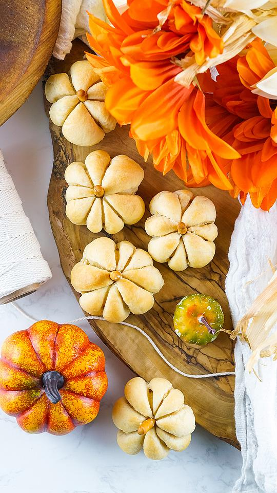 Food blogger, Bella Bucchiotti of xoxoBella, shares a recipe for cheese stuffed pumpkin shaped bites. You will love this appetizer made with cheese wrapped in Pillsbury crescent roll dough.