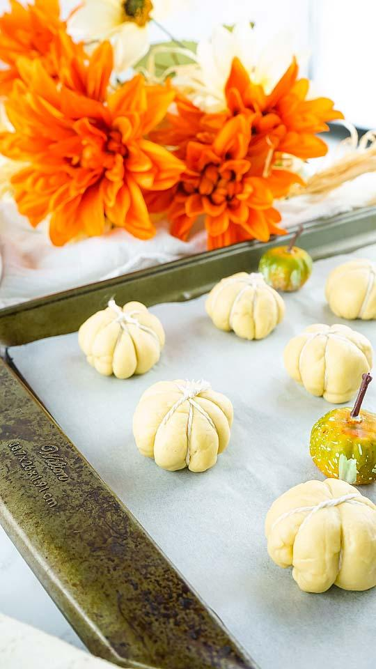 Food blogger, Bella Bucchiotti of xoxoBella, shares a recipe for cheese stuffed pumpkin shaped bites that are an easy crescent roll hack.