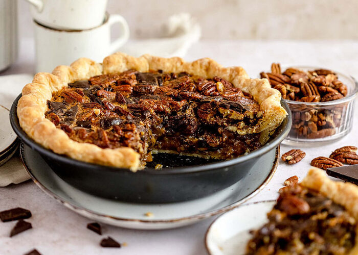 Food blogger, Bella Bucchiotti of xoxoBella, shares a recipe for chocolate chunk pecan pie for Thanksgiving or Christmas. You will love this gooey pecan and chocolate dessert.